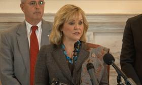 Governor Fallin addresses reporters regarding the tax cut.