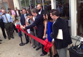 The Anaya family and City officials cut the ribbon on the new bakery.
