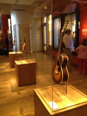 Several of the musician's instruments are on display at the Woody Guthrie Center.
