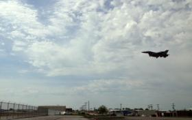 A Guard jet flies over North Sheridan on final approach to Tulsa International