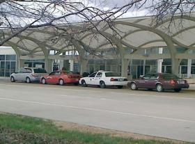 Taxi cabs parked out side for the Tulsa Airport