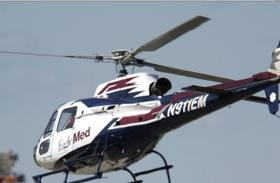 An EagleMed chopper lifts off from an accident scene.