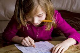 A young girl does her homework.