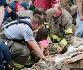 Rescuers respond to the injured following the Moore tornado.