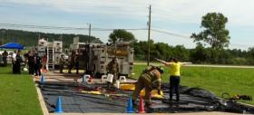 Victims are decontaminated at a simulated chemical emergency at the Port of Catoosa