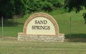 The welcome to Sand Springs sign on Highway 412