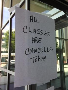 A sign on the door, announcing no classes because of fire