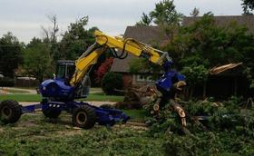 A grappling truck removes tree debris in Tulsa