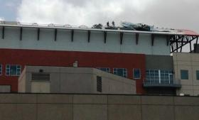 Crews work on the roof of the OSU Health Sciences Center
