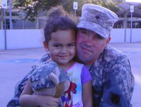 Veronica and her father, earlier this month as he was leaving for National Guard duty