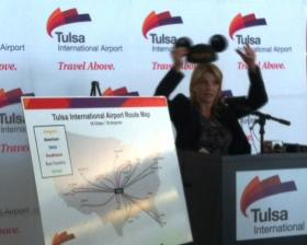 Tulsa Airport Authority Chair Mary Smith puts on mouse ears to announce new non-stop service to Orlando