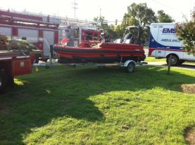 The Tulsa Fire Department's rescue boat is pulled from the Arkansas River after searching for the drowning victims