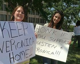 Two of the more than 50-protesters that showed up outside the Governor's Tulsa office on Saturday.
