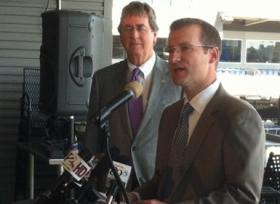 Sports Commission Director Ray Hoyt makes the announcement as Mayor Bartlett listens.