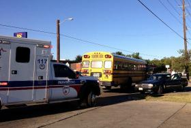 An EMSA ambulance is called to a school bus wreck, but is not needed.