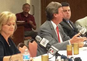 Mayor Bartlett answers a question as Kathy Taylor writes a note during the KWGS/Tulsa Kiwanis debate.