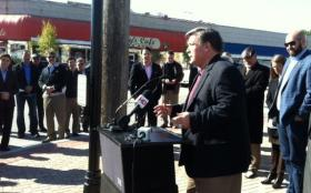 Author Michael Wallis speaks at the dedication of a new Route 66 Cultural Crossroads plaza