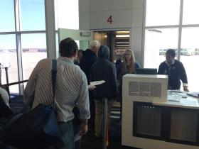 Passengers board Allegiant flight 705 from Tulsa International Airport to Orlando Sanford International Airport Friday.