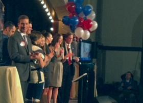Mayor Bartlett, in the red tie next to the ballons, and his family at a victory celebration at the Jazz Hall of Fame