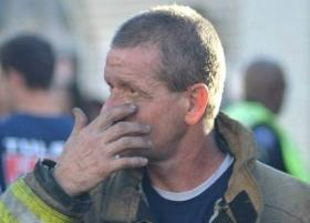 An exhausted Tulsa Fire Fighter following yesterday's fatal apartment fire