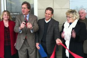 The ribbon is cut for a new Women's Health Clinic in the 61st and South Peoria neighborhood.