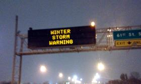 The highway sign near 169 and 61st Street in Tulsa