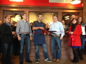 Albert G's owner Chuck Gawey cuts the ribbon Wednesday to mark the opening of Albert G's Bar & Q Downtown. The restaurant is at 421 E First St.