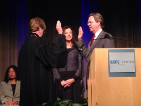 Tulsa Mayor Dewey Bartlett (right) takes the second oath of office for his second term Monday. U.S. District Court Judge Claire Eagan (left) administers the oath as Bartlett's wife, Victoria, looks on.