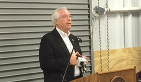 Cherokee Chief Bill John Baker takes part in a dedication for the new Collinsville food distribution center.