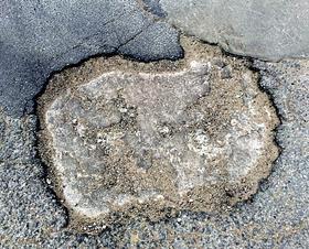 An Australian shaped Tulsa pothole.