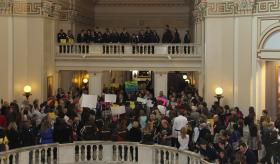 Protesters gather inside the state capitol to lobby lawmakers