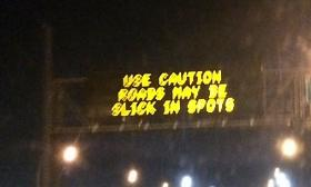 A sign warns Tulsa motorists to watch for slick roads
