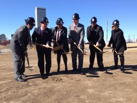 (From left) Tulsa Development Authority Chairman Julius Pegues, Tulsa Regional Chamber President and CEO Mike Neal, Yvonne Hovell, Mayor Dewey Bartlett, state Sen. Jabar Shumate and Tulsa County Commissioner Karen Keith toss shovelfuls of dirt at the groundbreaking ceremony for Urban 8, a condo development in downtown Tulsa's East Village area.