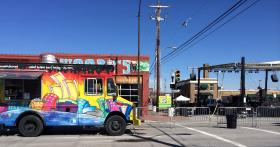 Food trucks, bars, and live music prepare early for the annual St. Patrick's Day festivities in the Blue Dome District.
