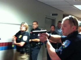 Police Officers respond to a call of shootings at the Jenks High School. It looks very real, but it's just an exercise to test emergency response policies.