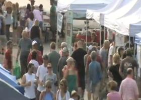 A crowd shops at the Cherry Street Farmer's Market