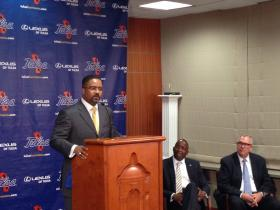 New TU men's basketball coach Frank Haith addresses fans and reporters at a news conference Friday. University athletics director and Vice President Derrick Gragg and President Steadman Upham (right) also spoke.