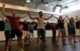 A Tulsa Flash Mob for the Arts rehearses before taking to the streets of Tulsa.