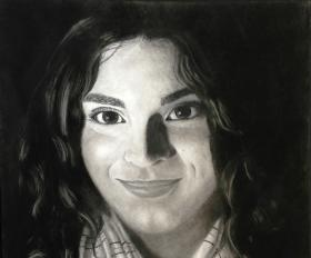 """Ashley Ghazal's charcoal and chalk piece, titled """"Her Eyes,"""""""