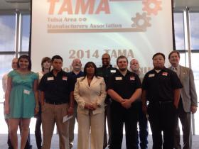 Students pursuing advanced manufacturing careers pose with Mayor Dewey Bartlett Friday after being awarded scholarships.