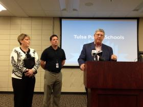 Tulsa Public Schools Superintendent Keith Ballard (right) speaks about the district's third-grade state reading test scores Friday afternoon. Chief Accountability Officer Chris Johnson and Chief Academic Officer Tracy Bales also spoke on the matter.