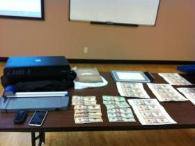 The fake money and equipment recovered in Tulsa today