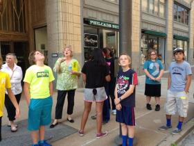 Students check out architecture in downtown Tulsa's Deco District during a Camp T Square walking tour.