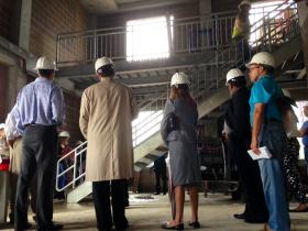 City officials and reporters check out Thursday the ground floor of a six-story fire training tower under construction at Tulsa Community College's Northeast Campus. The $13.2 million training facility should be completed by the end of November and in use by spring.