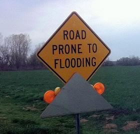 A sign, warning for a Tulsa area flood danger