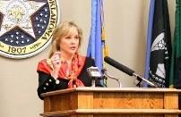 Mary Fallin speaking with reporters.