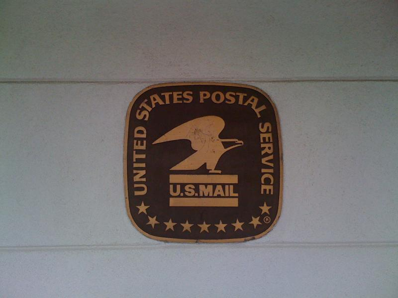 The Post Office sign on the side of the closing Whittier Station.