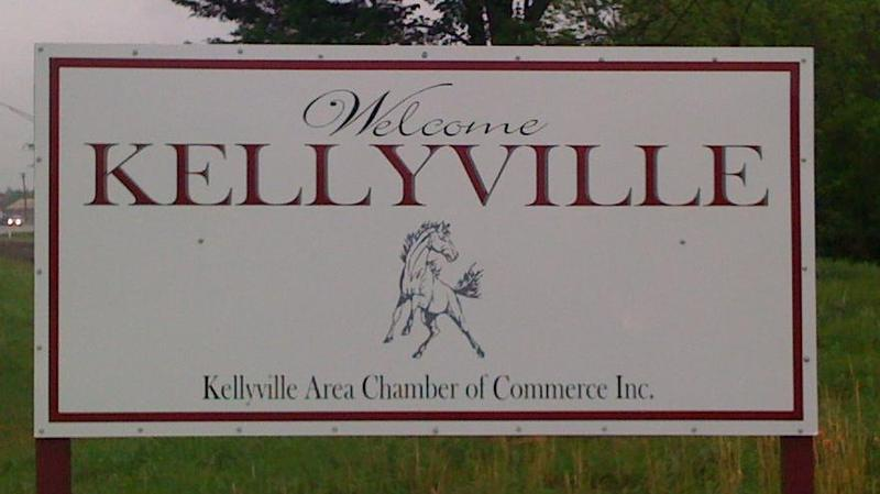 A sign welcomes travelers along Route-66 to Kellyville, Oklahoma.