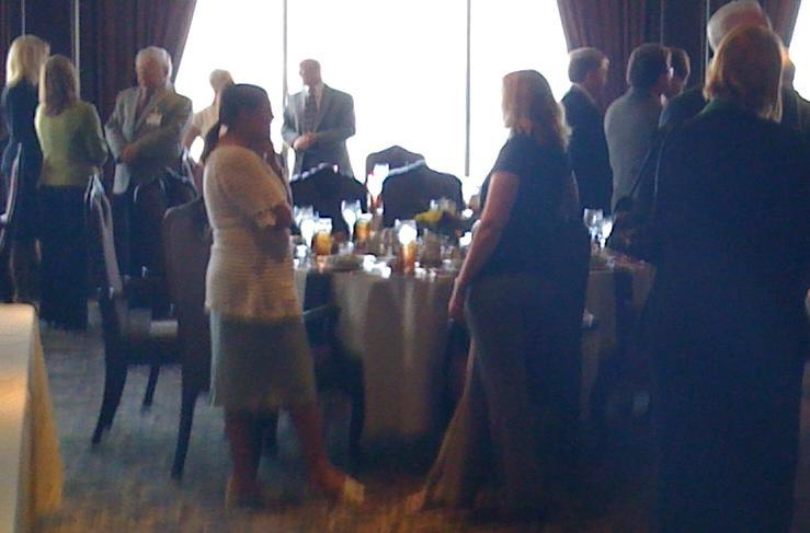 Delegates and Civic leaders mingle at a luncheon at Tulsa's Summit Club