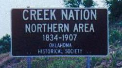 A sign marks the entrance into the Muskogee-Creek Nation.
